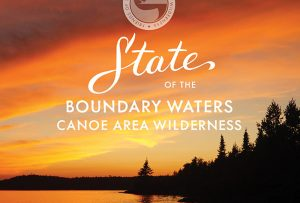 "Striking orange sunset photo featured on front cover of the Friends of the Boundary Waters Wilderness report ""State of the Boundary Waters Canoe Area Wilderness""; graphic design by Carolyn Porter of Porterfolio, Inc."