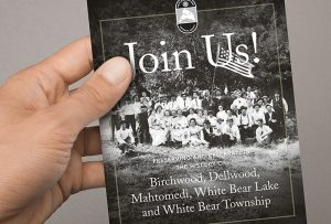 Hand holding small size membership brochure for White Bear Lake Area Historical Society; graphic design by Carolyn Porter of Porterfolio, Inc.